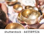 woman playing a singing bowls... | Shutterstock . vector #665589526