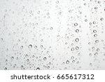 drops of rain on the window ... | Shutterstock . vector #665617312