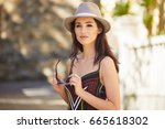 the girl visits a small town in ... | Shutterstock . vector #665618302