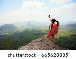 successful woman hiker taking... | Shutterstock . vector #665628835
