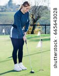 glad woman playing golf is... | Shutterstock . vector #665643028