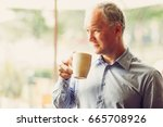 closeup of pensive middle aged... | Shutterstock . vector #665708926