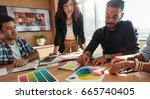 creative team brainstorming in... | Shutterstock . vector #665740405