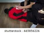 a police officer finds drugs... | Shutterstock . vector #665856226