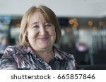 portrait of an smiling elderly... | Shutterstock . vector #665857846