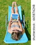 woman lying on lounger in... | Shutterstock . vector #665876248