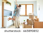 portrait of young couple moving ... | Shutterstock . vector #665890852