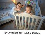 young tired mother got asleep... | Shutterstock . vector #665910022