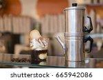 artisan preparation of a glass...   Shutterstock . vector #665942086