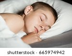 close up on boy partially... | Shutterstock . vector #665974942