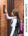 cute schoolgirl in school... | Shutterstock . vector #665984272