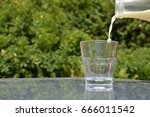 pouring milk into a glass | Shutterstock . vector #666011542