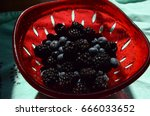 Small photo of Blueberries and blackberries rinsed in a bowl