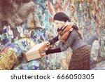 woman open suitcase in retro... | Shutterstock . vector #666050305
