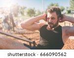 muscular man exercising doing... | Shutterstock . vector #666090562