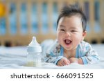 asian newborn baby smile with... | Shutterstock . vector #666091525