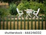 garden chairs and table behind...   Shutterstock . vector #666146032