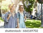 happy lesbian couple having... | Shutterstock . vector #666169702