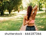 young female runner stretching... | Shutterstock . vector #666187366