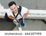 portrait of male photographer... | Shutterstock . vector #666187498