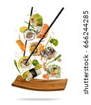 sushi pieces placed between... | Shutterstock . vector #666244285