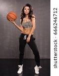 sexy brunette woman holding...   Shutterstock . vector #666246712
