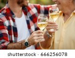 white wine in wineglass  ... | Shutterstock . vector #666256078