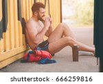 man eats a hamburger after a... | Shutterstock . vector #666259816