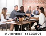 businesspeople shaking hands... | Shutterstock . vector #666260905