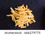 french fries on a dark...   Shutterstock . vector #666279775