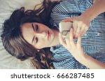 closeup of sad teenage girl... | Shutterstock . vector #666287485