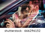 fashionable couple in a car  at ... | Shutterstock . vector #666296152