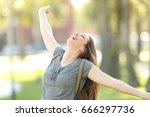 excited happy girl raising arms ... | Shutterstock . vector #666297736