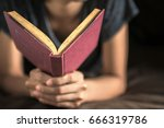 close up of young woman reading ... | Shutterstock . vector #666319786