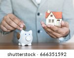saving money buy house   | Shutterstock . vector #666351592