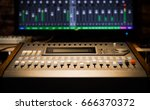 Small photo of sound mixer fader, signal level on screen. music technology background