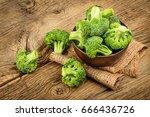 fresh broccoli on wooden...   Shutterstock . vector #666436726
