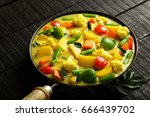 vegetarian curry cooked in... | Shutterstock . vector #666439702