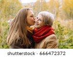 happy mother and daughter... | Shutterstock . vector #666472372