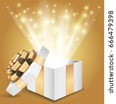 gift box with shining light.... | Shutterstock .eps vector #666479398