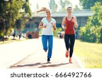 two young women are running in... | Shutterstock . vector #666492766