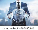 Businessman Holding Abstract...