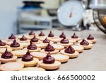 freshly baked macarons with... | Shutterstock . vector #666500002
