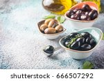 Small photo of bowls with different kind of olives green olives, black olives, kalamata olives with olive oil