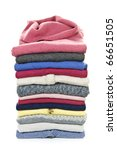 Stack of warm sweaters isolated on white background - stock photo