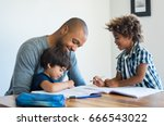 young black father helping his... | Shutterstock . vector #666543022