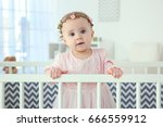 cute little girl standing in... | Shutterstock . vector #666559912
