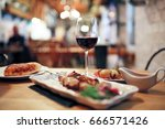 dinner on the table in the... | Shutterstock . vector #666571426