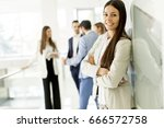 businesswoman posing while... | Shutterstock . vector #666572758