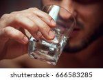 closeup of male adult drinking... | Shutterstock . vector #666583285